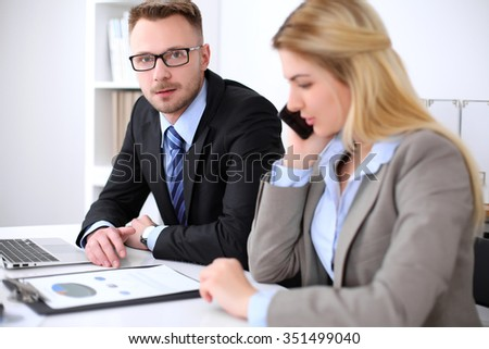 Two successful business partners working at meeting in office
