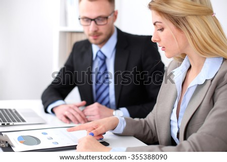 Two successful business partners working at meeting in office - stock photo