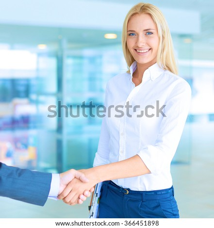 Two successful business people shaking hands with each other - stock photo