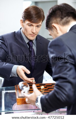 Two successful businessmen play a chessboard - stock photo