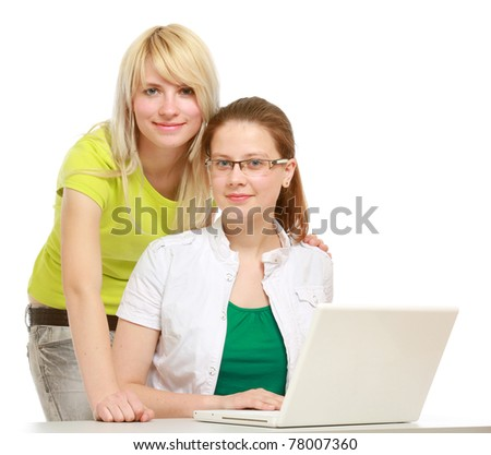 Two successful students looking at camera