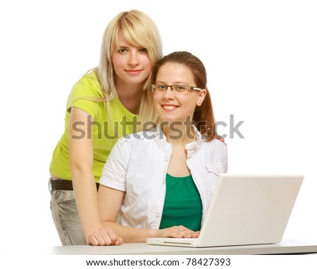 Two successful students looking at camera - stock photo