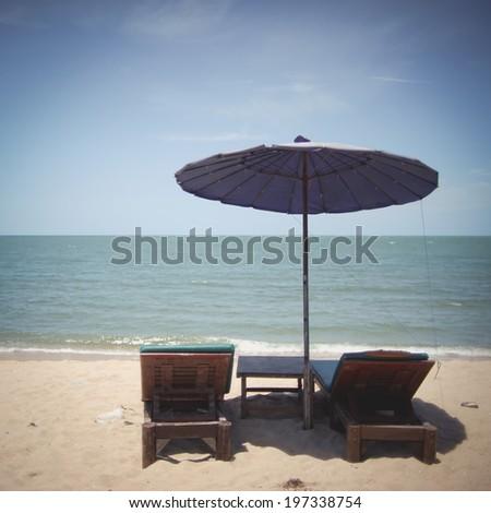 Two sun beach Vintage photo . - stock photo