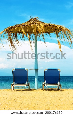 Two sunbeds at the beach. - stock photo