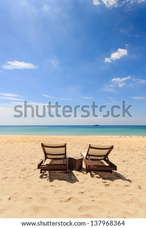 Two Sunbeds on the beach - stock photo