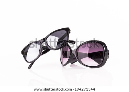 Two sunglasses isolated on white background - stock photo