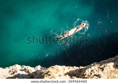 Two surfers on board - Portugal - stock photo