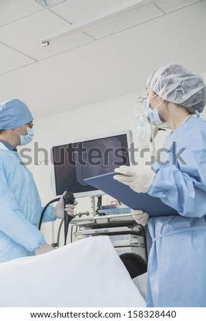 Two surgeons preparing for surgery