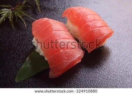 two sushi of raw tuna/sushi tuna - stock photo