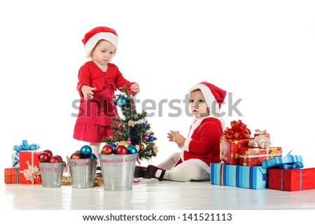 two sweet baby Santa helpers