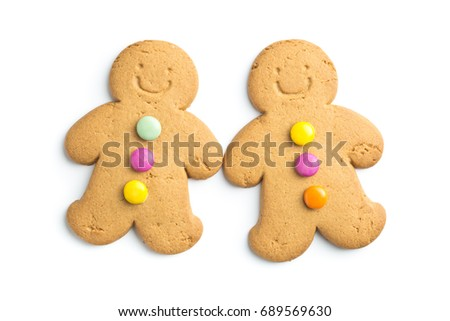 Two sweet gingerbread men isolated on white background. Xmas gingerbread.