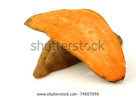 two sweet potato halves on a white background - stock photo