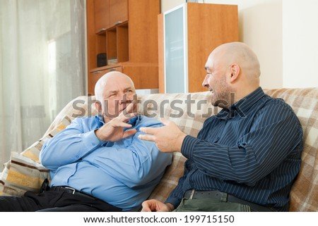 Two talking men  on  couch