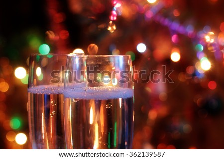 Two tall glass with a drink on the abstract background