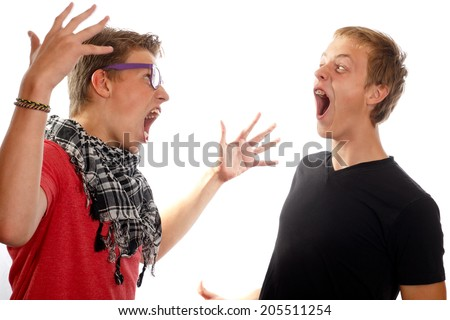 Two teen boys having a conflict, screaming at each other - stock photo