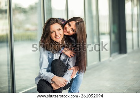 Two Teen Girl Friends Laughing. Selective focus - stock photo