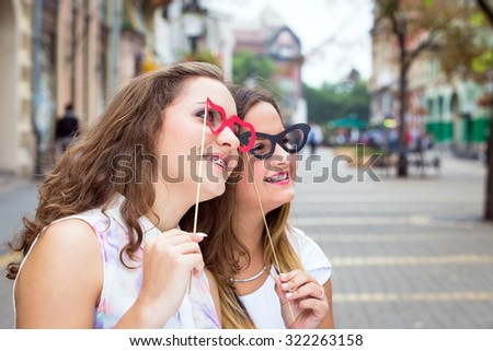 two teen girlfrends with mask on street