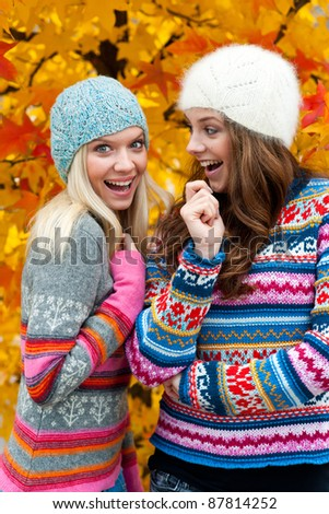 two teen girls chatting and smiling