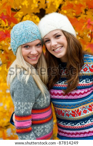 two teen girls chatting smiling and having fun