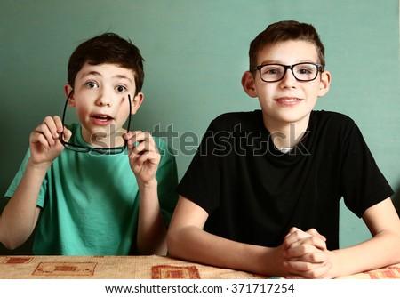 two teenage boy in myopia glasses close up portrait - stock photo