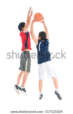 Two teenage boys playing basketball - stock photo
