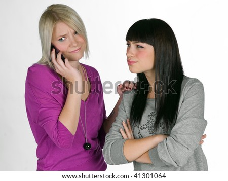 two teenage girlfriends with mobile phone