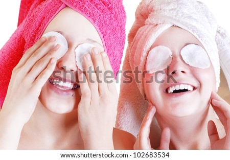 Two Teenage girls cares about skin near the eyes - stock photo