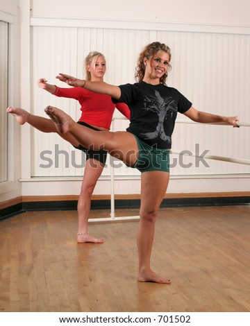 Two teenage girls dancing - stock photo