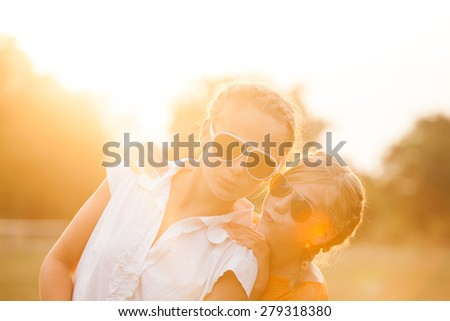 Two teenage girls have fun in the park. Two friends outdoor. Summer people in glasses - stock photo