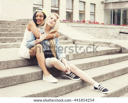 Two teenage girls infront of university building smiling, having fun, lifestyle people concept - stock photo
