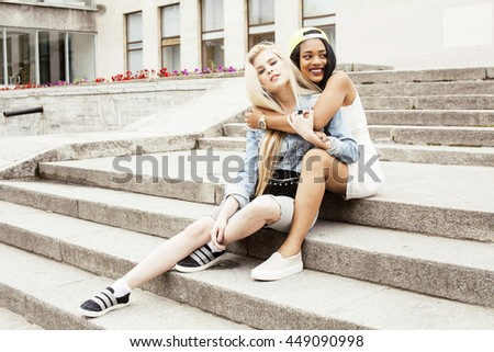 Two teenage girls infront of university building smiling, having fun, lifestyle people concept