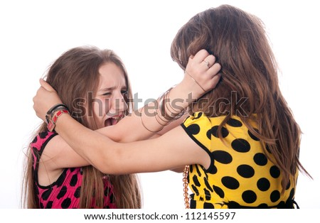 Two teenage girls pulling each others hair out isolated on white.
