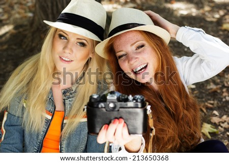 Two teenagers girl taking selfe with camera  - stock photo
