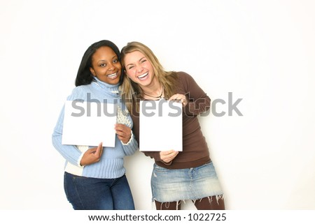 Two Teens Holding Signs - stock photo