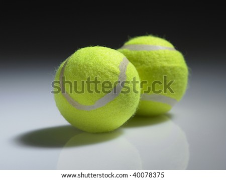 two tennis ball on the plain background