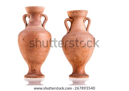two terracotta amphorae  isolated over a white background - stock photo