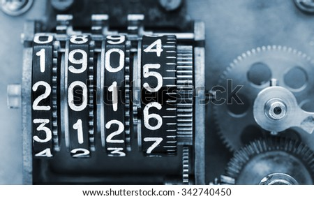 Two thousands fifteen and a half. The old, mechanical counter, with digits. - stock photo