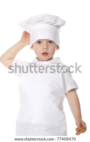 Two, three years old baby boy in a suit of the cook isolated on a white background