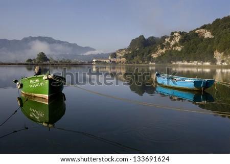Two tied boats.  Small fishing colored boats moored at Ribadesella, Asturias, North Spain, Europe. - stock photo