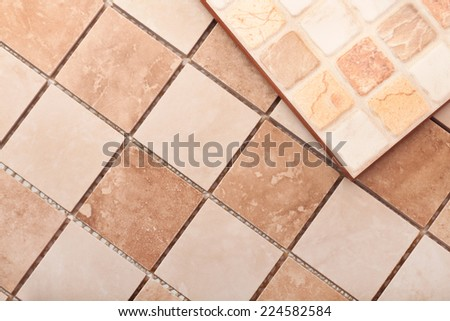 Two tiles, marble and ceramic - stock photo