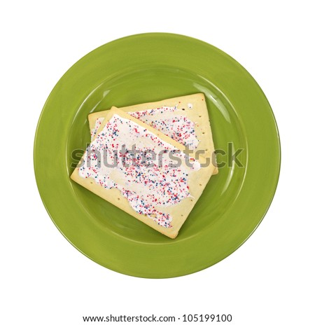 Two toaster pastries that have been cooked on a green plate. - stock photo