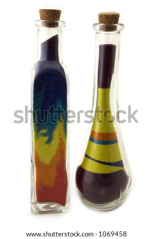 Two toll bottles with colorful sand