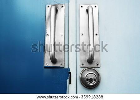 Two tone doors dark blue and light blue with steel handle door - stock photo