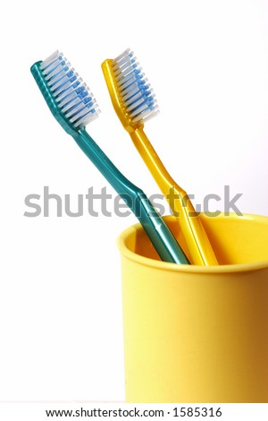 two tooth-brushes of different colour - stock photo