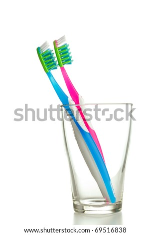 two toothbrushes in the glass isolated