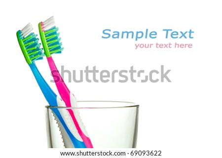 two toothbrushes in the glass with copy-space - stock photo