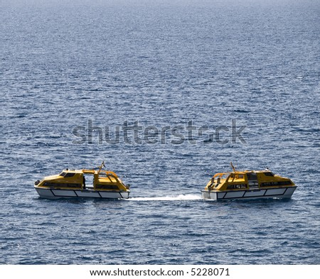 Two tourist boat passing by on the clear blue adriatic sea.