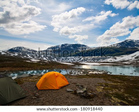 two tourist tents in mountains,  summertime, Norway - stock photo