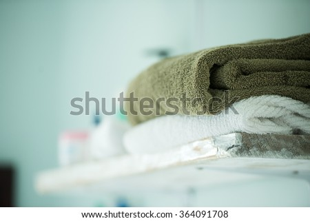 Two towels on a shelf in bathroom - stock photo