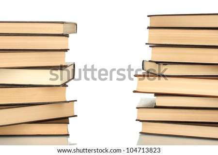 Two towers of books on white background close-up